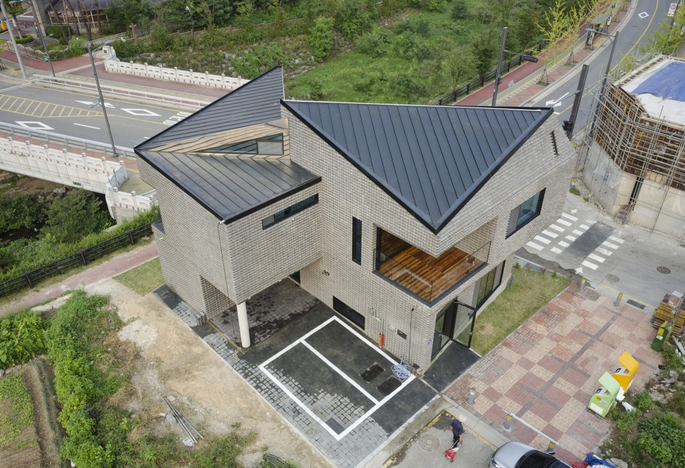 Modern Architectural Forms the scale-ing house in south korea is made of basalt-bricks